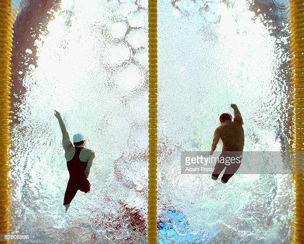 Vicente Javier Torres of Spain and Takayuki Suziki of Japan in action during the 150m Medley SM4 Swimming event at the National Aquatics Centre...
