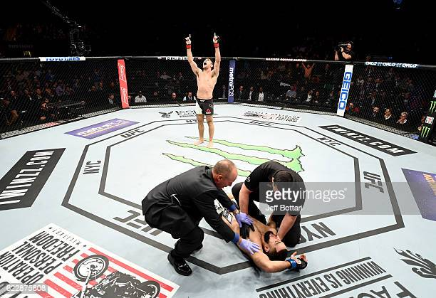 Vicente Luque of Brazil celebrates his win by TKO over Belal Muhammad of the United States in their welterweight bout during the UFC 205 event at...
