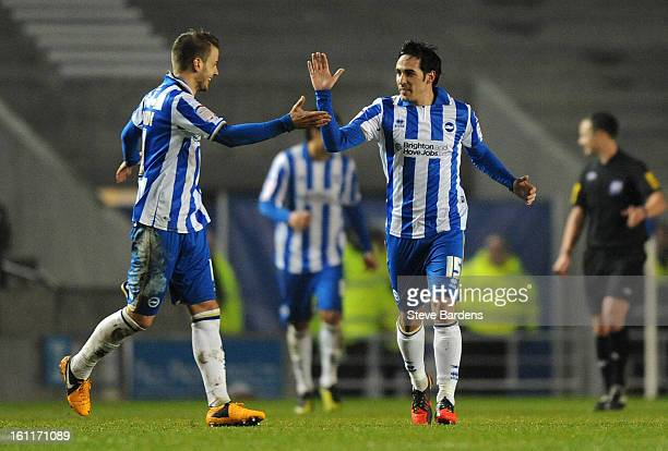 Vicente Rodriguez of Brighton Hove Albion celebrates scoring the only goal of the game from a free kick with his team mates during the npower...