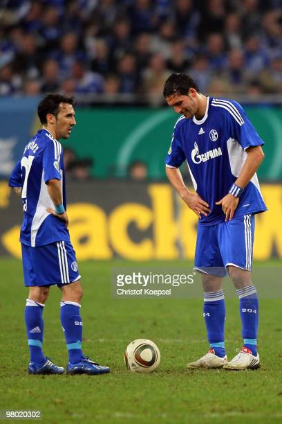 Vicente Sanchez of Schalke and Kevin Kuranyi of Schalke look dejected after the first goal of Bayern during the DFB Cup semi final match between FC...