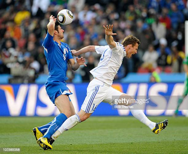 Vicenzo Iaquita of Italy challenges Jan Durica of Slovakia during the 2010 FIFA World Cup South Africa Group F match between Slovakia and Italy at...
