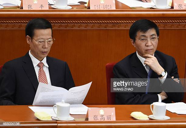 Vicepremier Zhang Gaoli and Wang Huning a member of the Political Bureau of the CPC Central Committee attend the opening session of the Chinese...