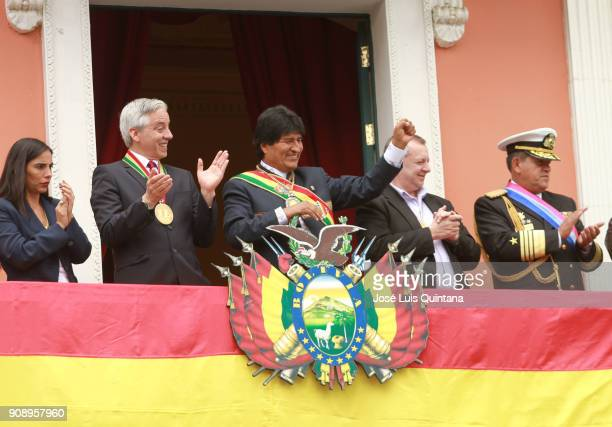 Vicepresident Alvaro Garcia Linera and President of Bolivia Evo Morales greet the crowd during the celebration of the 12th anniversary of Evo...