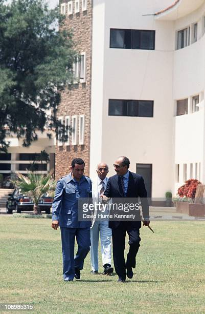 Vicepresident Hosni Mubarak walks alongisde President Anwar al Sadat as they stroll across the lawn of the presidential residence in Alexandria Egypt...