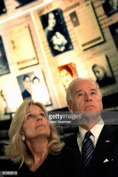 VicePresident Joe Biden and his wife Dr Jill Biden look up at the names and photographs of murdered Jews as they visit the Hall of Names in the Yad...