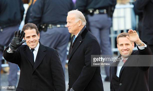 VicePresident Joe Biden and sons Hunter Biden and Beau Biden walk in the Inaugural Parade January 20 2009 in Washington DC Barack Obama was sworn in...