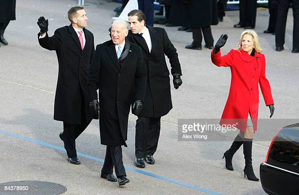 VicePresident Joe Biden arrives with his family wife Jill sons Hunter and Beau at the reviewing stand to watch the Inaugural Parade from in front of...