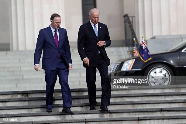 VicePresident Joe Biden chats with New Zealand Prime Minister John Key at the Auckland War Memorial Museum on July 21 2016 in Auckland New Zealand...