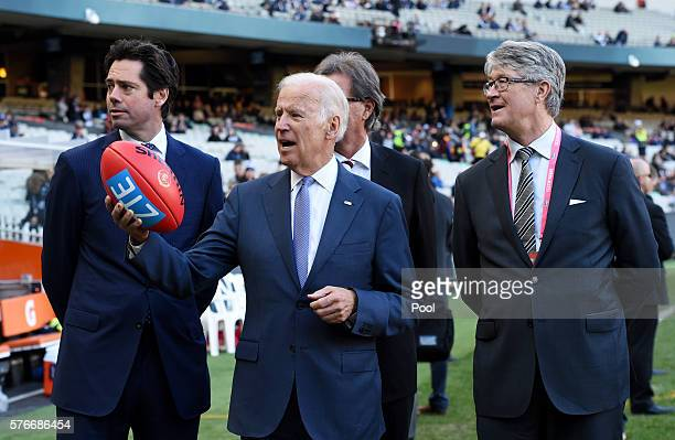 VicePresident Joe Biden holds an AFL football with AFL CEO Gillon McLachlan and Mike Fitzpatrick and Chair of the MCC Steven Smith before the round...