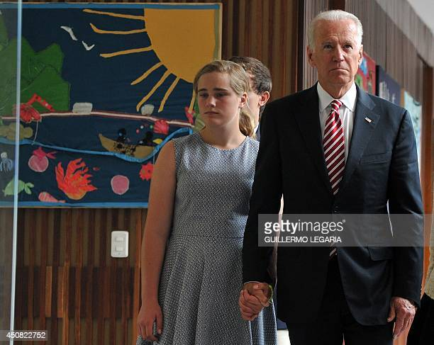 US VicePresident Joe Biden visits with his granddaughter Maisy the Center for Memory and Reconciliation in Bogota a museum about the victims of the...