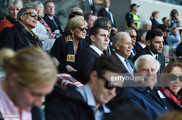 VicePresident Joe Biden with Mason Cox and Foreign Minister Julie Bishop and her partner David Panton watch the round 17 AFL match between the...