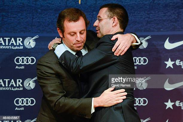 VicePresident Josep Maria Bartomeu hugs FCB President Sandro Rosell after the press conference announcing his resgination as FCB president on January...