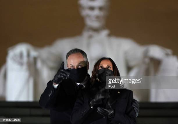 Vice-President Kamala Harris and her husband Doug Emhoff attend a televised ceremony at the Lincoln Memorial on January 20, 2021 in Washington, DC....
