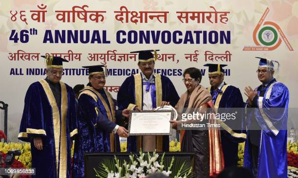 VicePresident M Venkaiah Naidu gives the Lifetime Achievement Award to Dr Kamal Buckshee during the 46th Annual Convocation of All India Institute of...