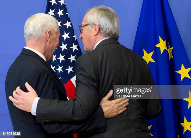 US VicePresident Mike Pence meets with European Commission President JeanClaude Juncker at the European Commission in Brussels on February 20 2017...