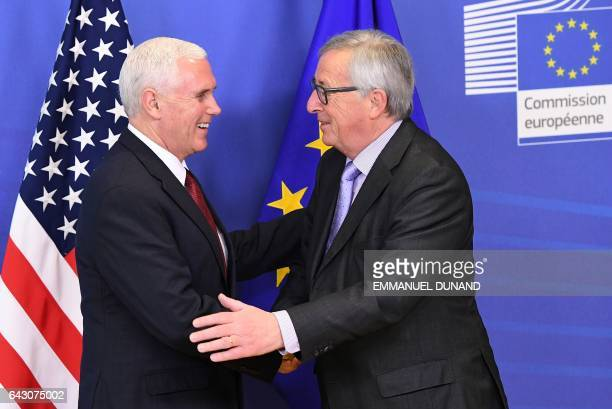 US VicePresident Mike Pence shakes hands with European Commission President JeanClaude Juncker at the European Commission in Brussels on February 20...