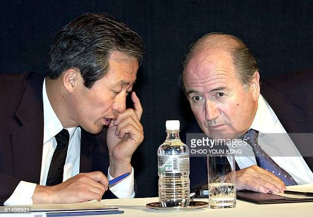 VicePresident of FIFA South Korean Chung MongJun talks to FIFA President Joseph Blatter in a whisper during a press conference in Seoul 29 May 2001...