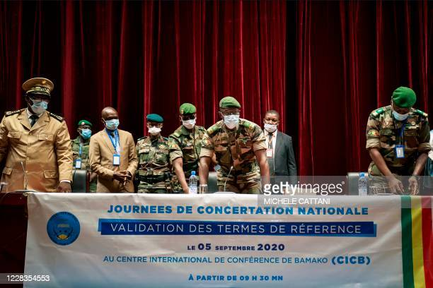Vice-President of the CNSP Colonel Malick Diaw takes a seat with other military leaders during the opening of two days of talks aimed at validating...