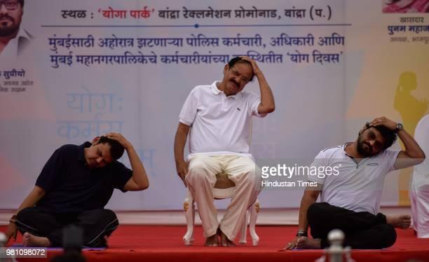 VicePresident Venkaiah Naidu with Maharashtra Chief Minister Devendra Fadnavis and Union minister Babul Supriyo as they perform yoga at Bandra...