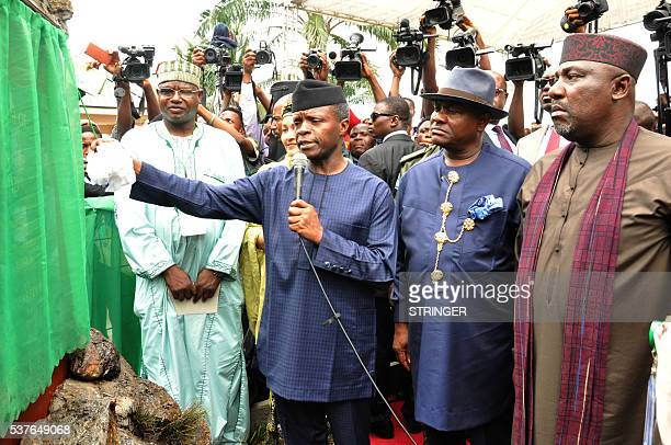 Vicepresident Yemi Osinbajo unveils a commemorative plaque to launch the clean up of Ogoniland accompanied by Rivers State Governor Nyesom Wike and...