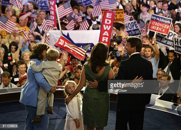 Vicepresidential candidate John Edwards is joined by his daughter Emma Claire his wife Elizabeth and his son Jack after he spoke at the Democratic...