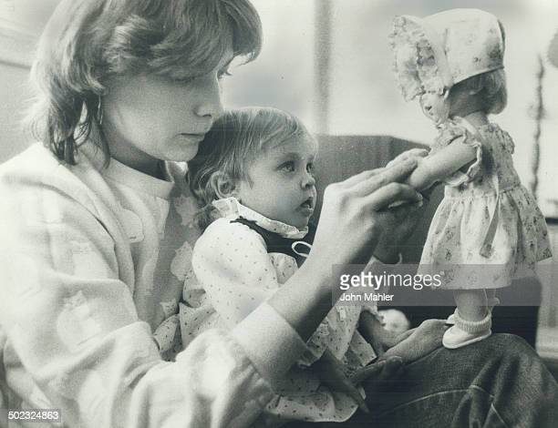 Viceregal doll Mom Christine Eberhardt and baby Lindsay play with a doll that LieutenantGovernor John Black Aird gave the ailing girl during a...