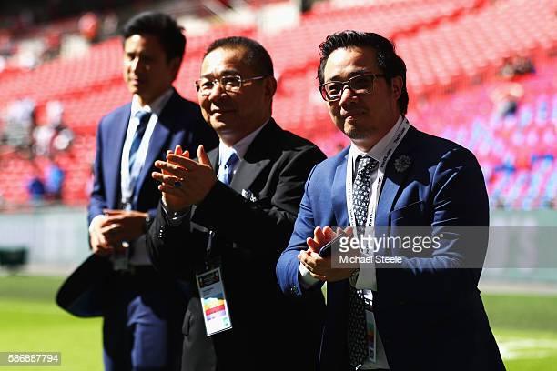 Vichai Srivaddhanaprabh and Aiyawatt Srivaddhanaprabha walk around the Wembley pitch prior to kick off during The FA Community Shield match between...