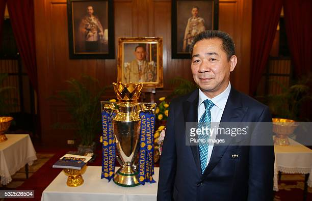 Vichai Srivaddhanaprabha Chairman and Owner of Leicester City poses with the Premier League Trophy during a visit to the Emerald Palace on May 19...