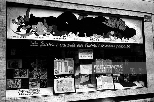 Vichy government AntiSemitic and antiMasonic poster of the French League 19391944 France Second World War war