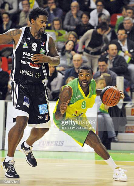 Vichy's Jamal Schuler vies with Limoges' Chris Massie during their French ProA basketball match on October 16 2010 in Vichy AFP PHOTO THIERRY ZOCCOLAN