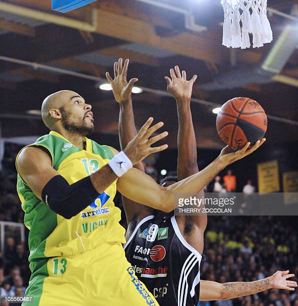 Vichy's Jonathan Aka vies with Limoges' Chris Massie during their French ProA basketball match on October 16 2010 in Vichy AFP PHOTO THIERRY ZOCCOLAN
