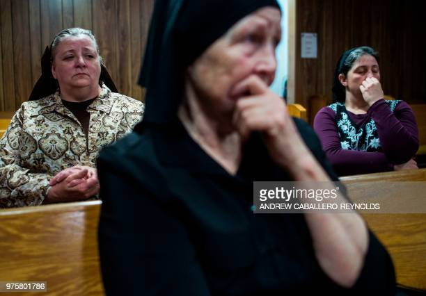Vicie Haywood Fran Woolford and Robin Brandon pray during a Pentecostal serpent handlers service at the House of the Lord Jesus church in Squire West...