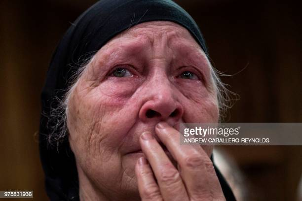 Vicie Haywood mother of pastor Chris Wolford cries during a Pentecostal serpent handlers service at the House of the Lord Jesus church in Squire West...