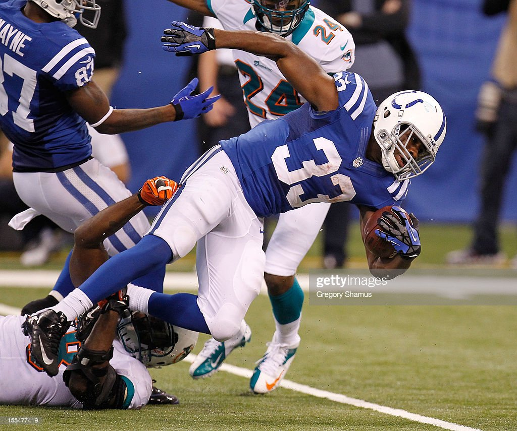 Vick Ballard #33 of the Indianapolis Colts battles to escape the tackle of Karlos Dansby #58 of the Miami Dolphins at Lucas Oil Stadium on November 4, 2012 in Indianapolis, Indiana. Indianapolis won the game 23-20.