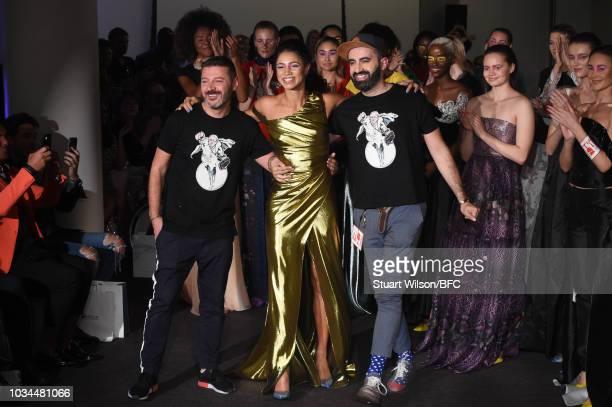 Vick Hope walks the runway at the Kolchagov Barba show during London Fashion Week September 2018 at The BFC Show Space on September 16 2018 in London...