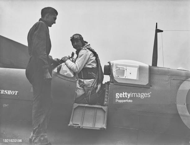 Vickers Armstrong chief test pilot Alex Henshaw climbs in to the cockpit of a brand new Supermarine Spitfire fighter aircraft for a test flight at...