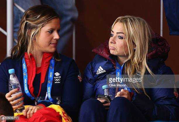 Vicki Adams and Anna Sloan of the Great Britain Women's Curling team look on during the Men's Gold Medal match between Canada and Great Britain on...