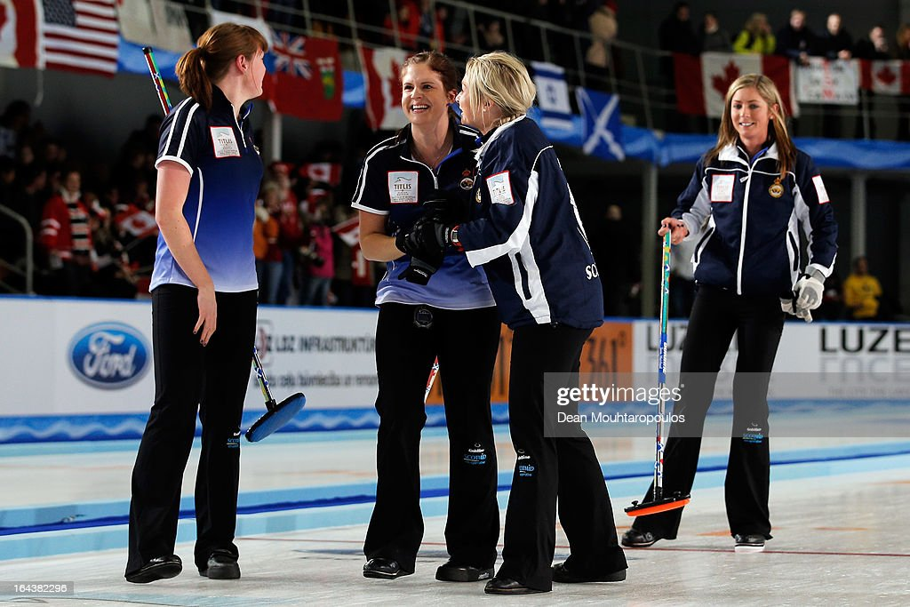 Vicki Adams, Eve Muirhead, Anna Sloan and Claire Hamilton of Scotland celebrate after they win the Semi Final match between Scotland and Canada on Day 8 of the Titlis Glacier Mountain World Women's Curling Championship at the Volvo Sports Centre on March 23, 2013 in Riga, Latvia.