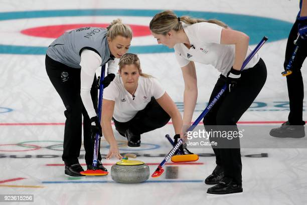 Vicki Adams of Great Britain throws a stone surrounded by Anna Sloan and Lauren Gray during the women's curling semifinal game between Sweden and...