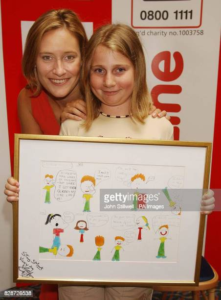 Vicki Bott from Bolton with BBC TV news presenter Sophie Raworth and her award winning cartoon which she entered in the Childline Cartoon Crazy...