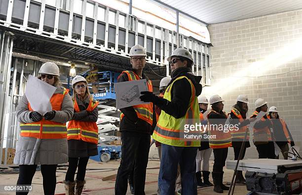 Vicki Bradham project manager from Aurora's Public Works department leads a tour for city employees of the ongoing construction site of the new 30000...