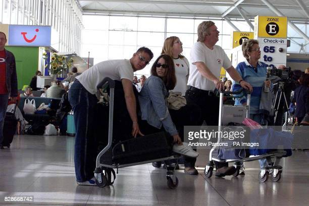 Vicki Leon from Bournemouth and her boyfriend Daniel Martin from Poole checkin at Stansted airport Essex for their flight to Milan as they join the...