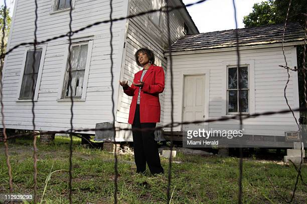 Vicki Oldham stands next to a Civil War era house in Bradenton, Florida, September 3, 2007. Oldham is part of an effort to help preserve an area on...