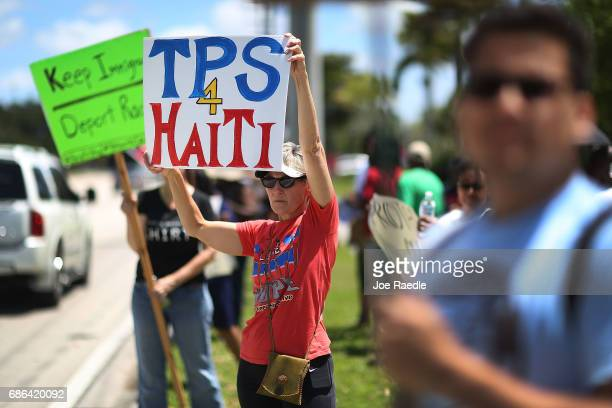 Vicki Rosenthal and others protest in front of the United States Citizenship and Immigration Services office in Broward county to urge the Department...