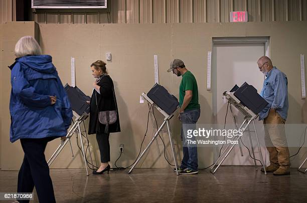 Vicki Slater a Democratic activist votes at Highland Chapel a polling place on election day in Madison MS on November 8 2016 Slater has been...