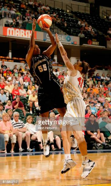 Vickie Johnson of the San Antonio Silver Stars shoots over Tully Bevilaqua of the Indiana Fever at Conseco Fieldhouse on June 15 2008 in Indianapolis...