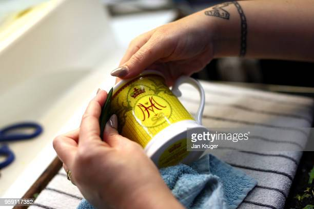 Vicky Bostock applies a lithography on a cup as part of a special collection ahead of the wedding of Prince Harry and Meghan Markle at William...