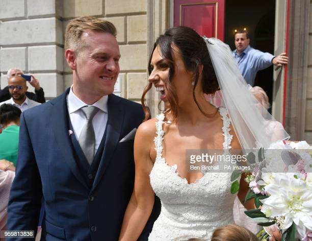 Vicky Compson and Aron Hallam outside Windsor Guildhall following their wedding the day before Prince Harry and Meghan Markle tie the knot in the...
