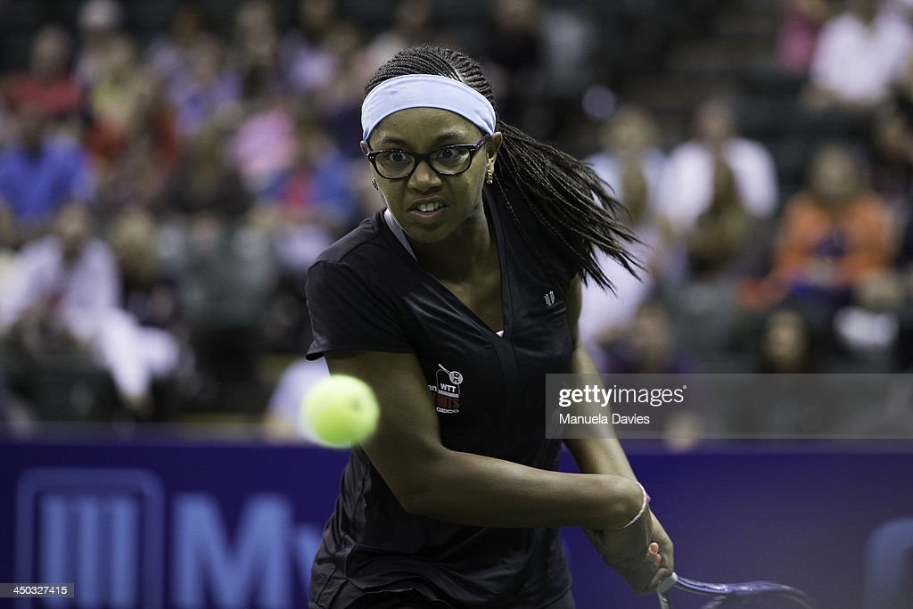 Vicky Duval of the U.S. hits a backhand during the exhibition doubles match against John Isner and Taylor Townsend during the 2013 Mylan WTT Smash Hits on November 17, 2013 at the ESPN Wide World of Sports Complex in Lake Buena Vista, Florida.