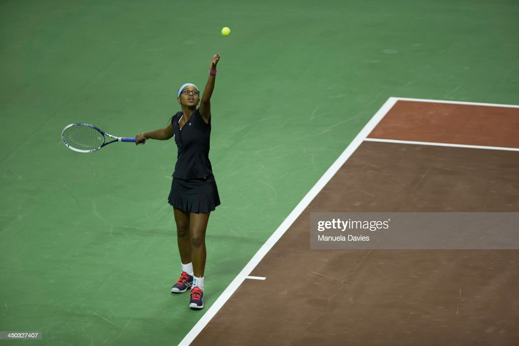 Vicky Duval of the U.S. serves during the exhibition singles match against Taylor Townsend during the 2013 Mylan WTT Smash Hits on November 17, 2013 at the ESPN Wide World of Sports Complex in Lake Buena Vista, Florida.